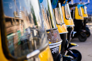 Indian auto rickshaw in line for service