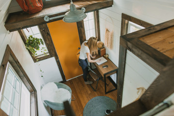 girl in tiny house