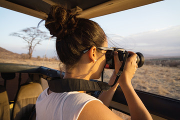 Young woman photographing in Africa