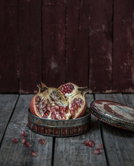 Pomegranate in a vintage can with red background