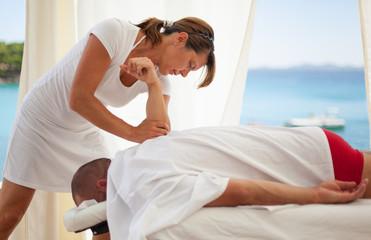 Man receiving back massage at the spa resort