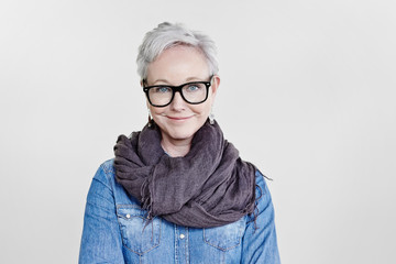 Portrait of stylish mature woman with grey hair