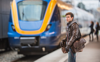 young man waiting for a train