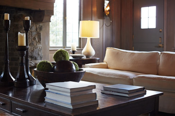 Detail of sofa and coffee table in living room of luxury home