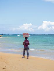 male seller on the Caribbean beach