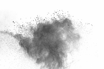 Abstract freeze motion of black dust explosion on white background. Stopping the movement of dark powder on white background. Explosive powder black on white background.