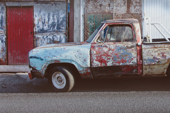 Old colorful vintage truck in poor condition