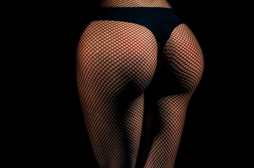 Ass and hips wearing black fishnet pantyhose tights and panties