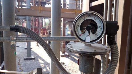 Pressure idicator installed on the pipeline. Measurement of water pressure in industrial plant.