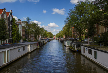 One of the city canals of Amsterdam  and typical Houseboats. Holland, Netherlands.