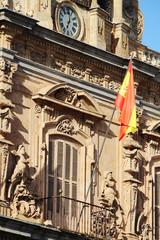 A Spanish flag at facade, The Plaza Mayor, Salamanca, Spain