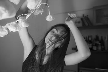 Beautiful woman and paper flowers dancing