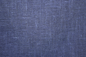 Blue linen cloth close-up background. Fabric texture.