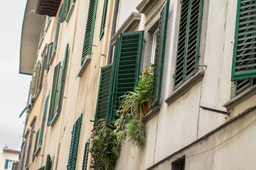 Old house with shutters in Florence, Italy