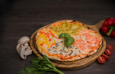 Hot piece of pizza with melted cheese on a rustic wooden table