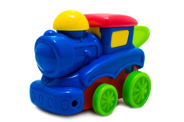 Multicolored bright plastic toy steam locomotive isolated on white background