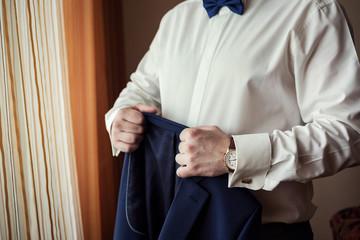 Businessman wears a jacket. Sharp dressed fashionist wearing jacket. Stylish man in blue jacket. Stylish handsome young man wearing jacket