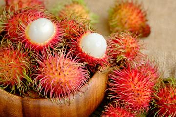 Rambutan fruit in wooden bowl