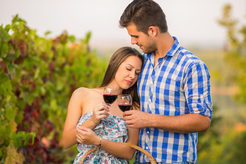 Young couple celebrating their anniversary in vineyard