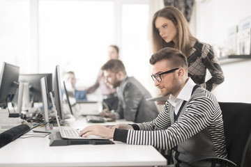 Young businessman is using computer to show his work to his manager