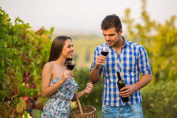 Farming couple drinking wine during the harvest