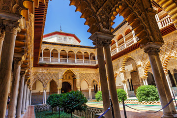Palace of Alcazar, Famous Andalusian Architecture. Old Arab Palace in Seville, Spain. Ornamented Arch and Column. Famous travel destination.