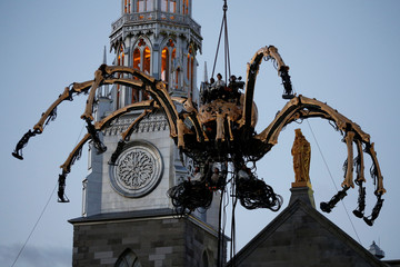 The giant mechanical spider Kumo is lowered in front of the Notre-Dame Cathedral Basilica in Ottawa