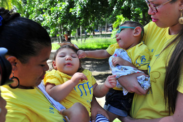 Mothers and relatives of children born with microcephaly protest against the government, demanding more support, in Recife