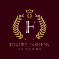 "Luxury Fashion calligraphic crown key letter ""F"" monogram logo. Laurel elegant beautiful round logo with crown and key. Vector letter sign F for Royalty, Restaurant, Boutique, Hotel, Heraldic, Jewelry"