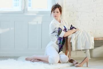 Attractive woman sitting on floor