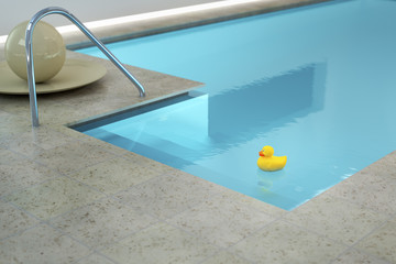 yellow rubber duck in an indoor pool