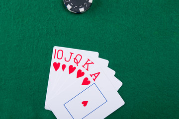On the green game table is a win of five cards