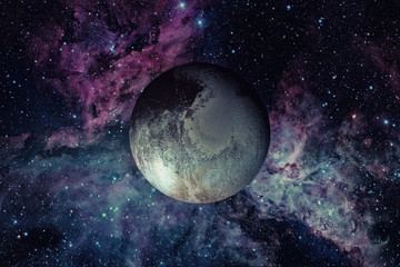 Pluto is a dwarf planet in the Kuiper belt. Elements of this image furnished by NASA.