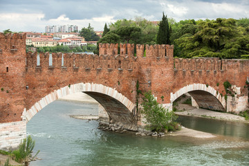 The Ponte Pietra (Stone Bridge), once known as the Pons Marmoreus, is a Roman arch bridge crossing the Adige River in Verona, Italy. The bridge was completed in 100 BC,