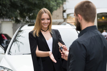 Blonde girl gets a gift from the car