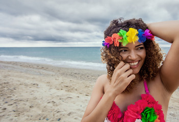 Portrait of gorgeous hawaiian woman wearing colorful accessories and smiling