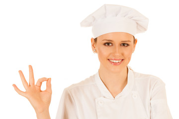 Beautiful young chef woman gestures excelent isolated over white background
