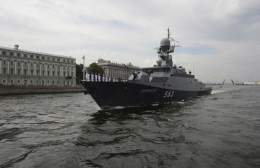 """The Russian small missile ship """"Serpukhov"""" sails on the Neva River during a rehearsal for the Navy Day parade in St. Petersburg"""