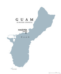 Guam political map with capital Hagatna, also known as Agana. Unincorporated and oganized territory of United States in western Pacific Ocean. Gray illustration over white. English labeling. Vector