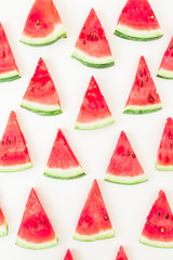 Sliced red watermelon on white background. Summer concept. Flat lay, top view