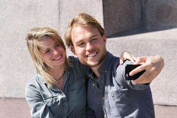 Young man making selfie with his girlfriend