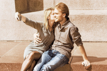 Young girl making selfie with her boyfriend while dating