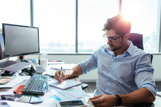Businessman working at his desk in office.