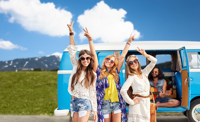 happy hippie friends at minivan car outdoors