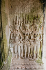 Ancient stone carving khmer style Apsaras on the wall in Angor Wat, Cambodia
