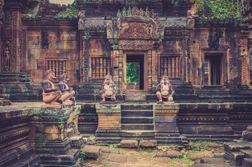 View of Banteay Srei sand stone temple with decoration statue figures in Angor Wat, Cambodia