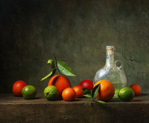 Still life with citrus fruit and jug