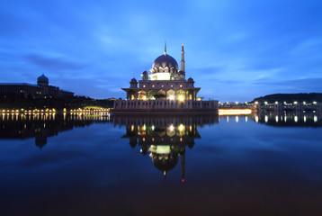 Breathtaking sunrise views with Putra Mosque, Putrajaya,  Malaysia. Charming Islamic architecture.
