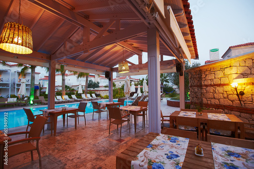 Evening View Of Cozy Small Mediterranean Boutique Hotel Pool With Chaise Longue Relaxing