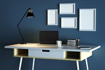 Designer desktop with blank laptop